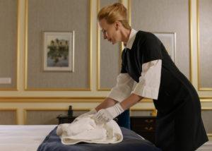 maid folding towels